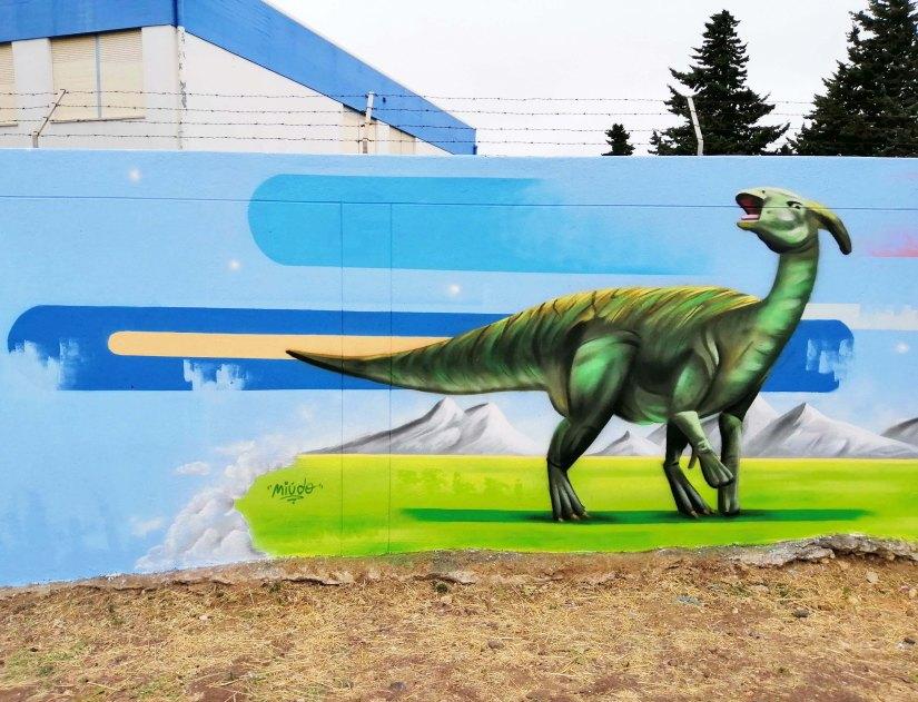 Arte urbana sobre dinossauros por Miúdo