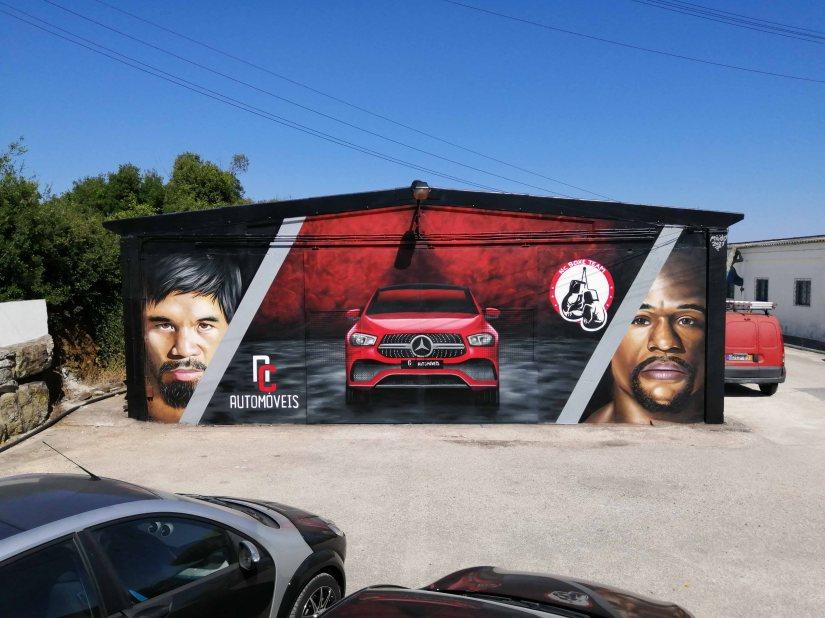 Arte urbana sobre boxe e automóveis